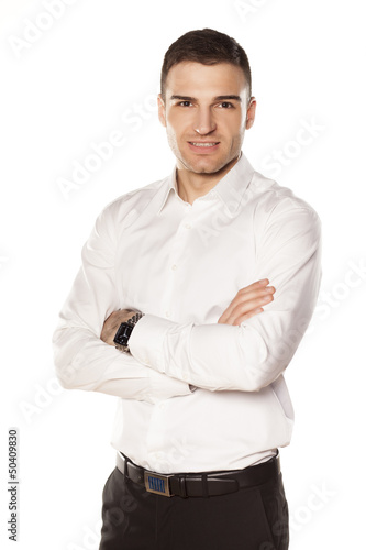 businessman in white shirt with his hands crossed on his chest