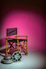 Film director's chair with movie reel - space for text