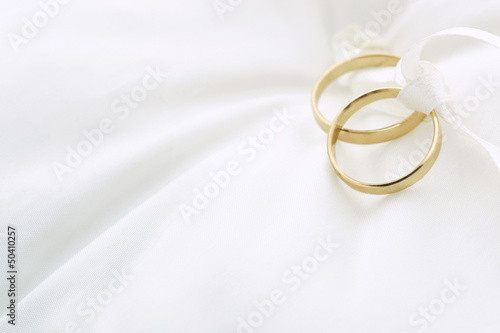 canvas print picture Wedding rings on ring pillow with copy space