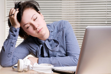 Woman sleeps on the workplace