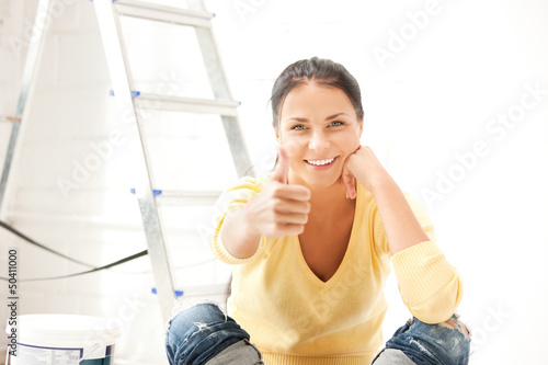 lovely housewife making repairing works