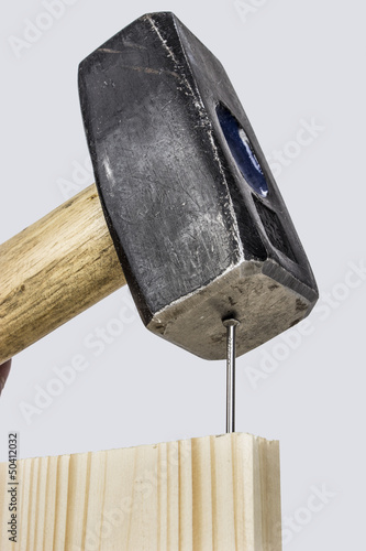 Hammer auf Nagel