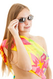 young sexy blonde woman with sunglasses wearing a bright pareo poster