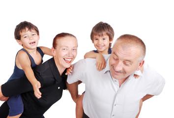 Grandparents piggybacking their boys