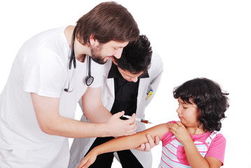 Adult doctor giving injection to young female patient