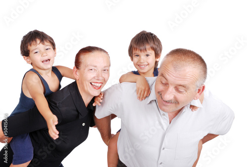 Grandparents piggybacking their boys