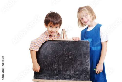 Schoolkids writing stuff on blackboard