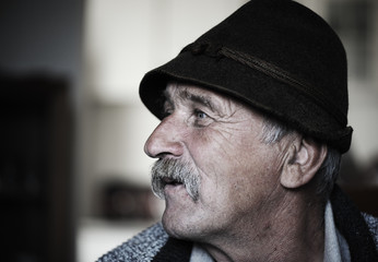 Portrait of old man with mustache, grain added