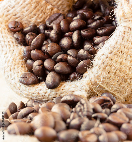 Roasted coffee beans in jute bag