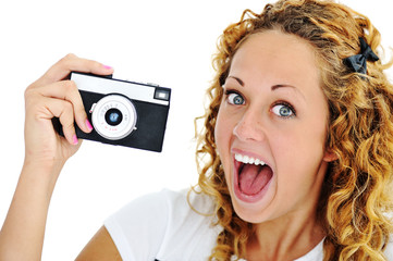 An excited teenage girl shouting holding a retro camera in hand