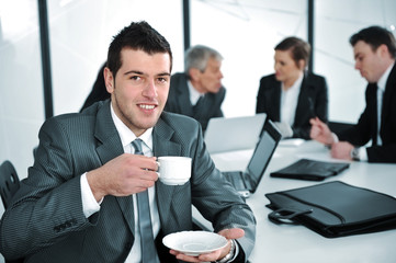Businessman in business ambience drinking cofee