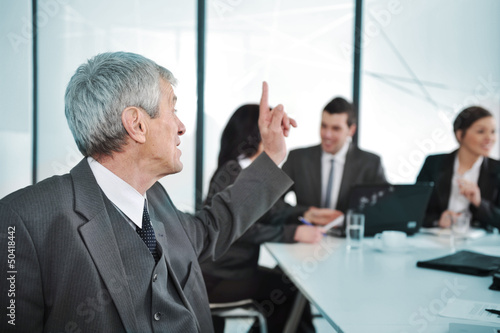 Senior businessman at a meeting.
