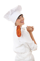 lady cook in white uniform and hat with raw meat