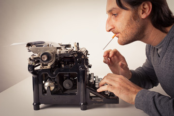 Man thinking at typewriter