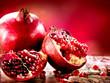 Pomegranates over Red Background. Organic Bio fruits