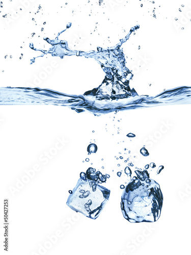 ice cubes splash in water isolated on white