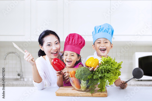 Happy family cook in kitchen