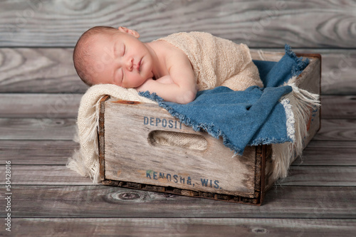 Newborn Baby Boy Sleeping in a Vintage Wooden Crate