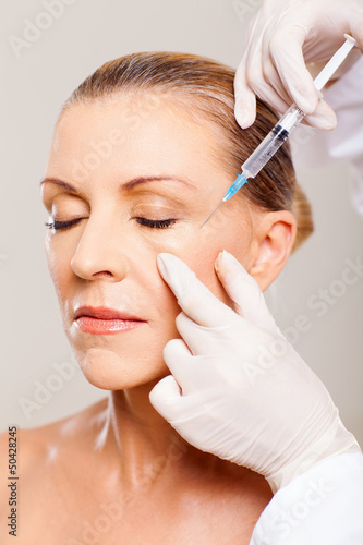 senior woman receiving plastic surgery injection