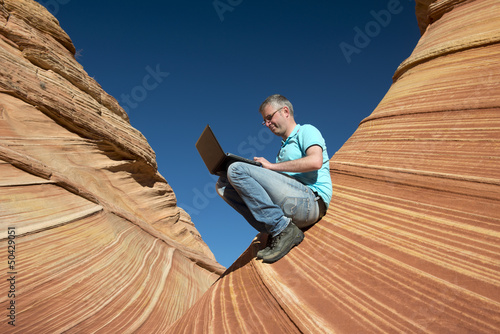 Business man in a canyon