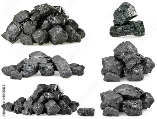 canvas print picture Set of piles of coal isolated on white