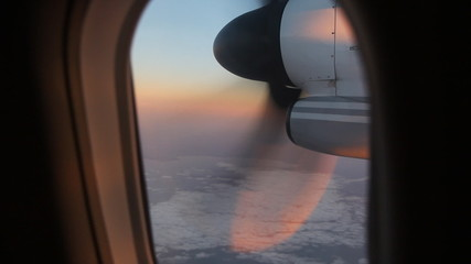 Morning flight with detail of turboprop engine.
