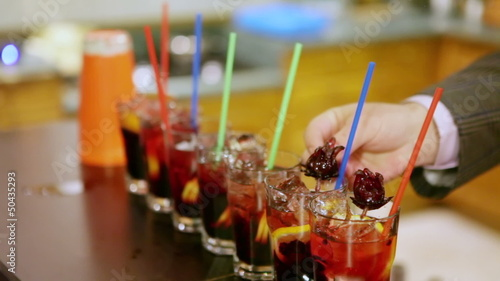 Bartender drinks decorated candied hibiscus flowers