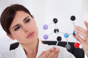 Scientist Looking At Dna Molecular Structure