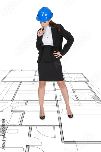 Female Architect Standing Over Blueprint