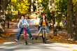 Urban biking - teens riding bikes in city park