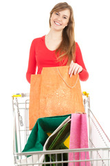 young woman with bags and shopping  trolley