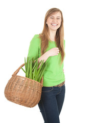 cheerful shopping girl with wicker basket