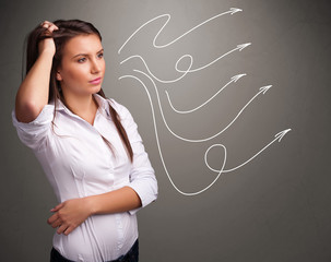 Attractive teenager looking at multiple curly arrows