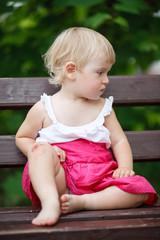 little girl on park bench