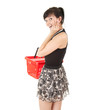 surprised young woman with red shopping basket