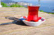 turkish tea on a table on nature with sea view
