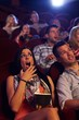 Young woman shocked at cinema