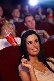 Beautiful girl in cinema smiling