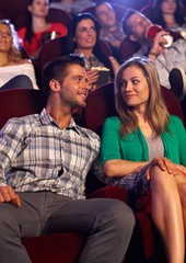 Young couple dating at cinema