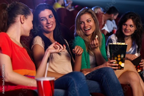 Pretty girls in cinema talking smiling