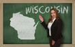 Teacher showing map of wisconsin on blackboard