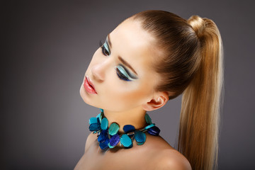 Profile of Sensual Woman with glazed Green - Blue Jewels. Relax
