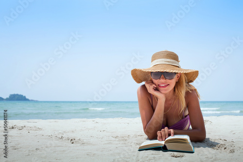 canvas print picture holidays on the beach, smiling woman in hat