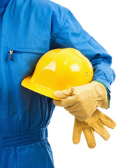 Yellow hardhat under arm