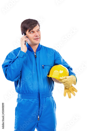 Portrait of a constuction worker talking on phone