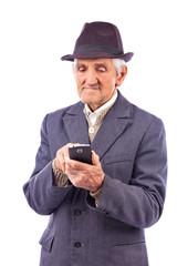 Portrait of an elderly man using mobil phone