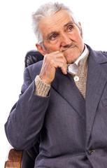 Closeup of an elderly man looking away in deep thought