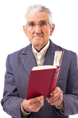 Portrait of an old man with glasses holding a red book