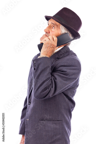 Portrait of a  senior talking on phone and looking away