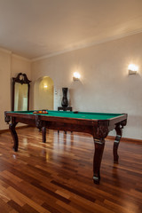 Cloudy home - billiard in living room